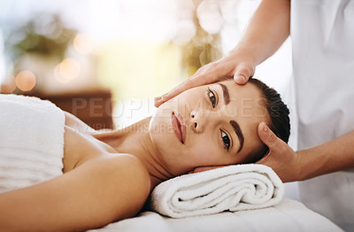 Buy stock photo Cropped shot of a beautiful young woman getting a head massage at a spa