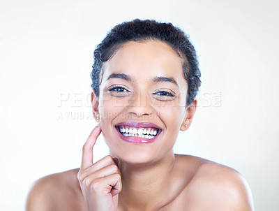 Buy stock photo Studio shot of a beautiful young woman posing against a light background