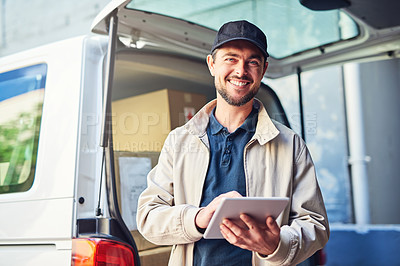 Buy stock photo Portrait of a courier using a digital tablet while checking the deliveries in his van