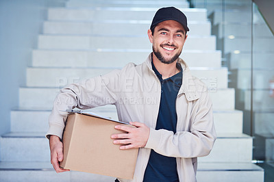 Buy stock photo Portrait of a courier making a delivery in an office