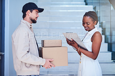 Buy stock photo Shot of a businesswoman signing for her delivery from the courier