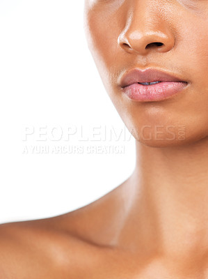 Buy stock photo Studio closeup of an unrecognizable woman standing against a white background during the day