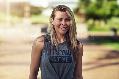 Buy stock photo Cropped portrait of an attractive young woman standing outside in the park