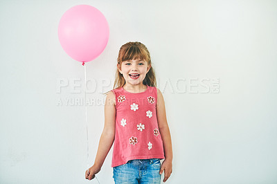 Buy stock photo Studio shot of an adorable little girl holding balloons against a grey background