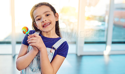 Buy stock photo Portrait of an adorable little girl holding a lollipop sucker at home
