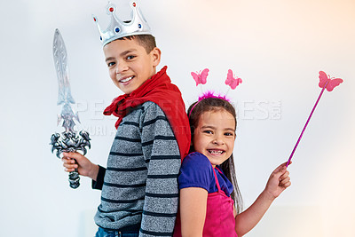 Buy stock photo Portrait of two adorable young children playing dress up for halloween at home
