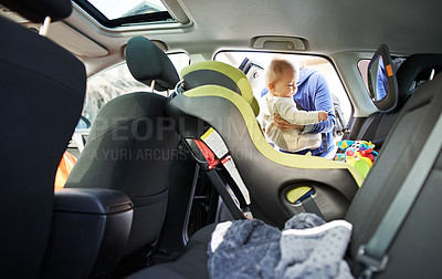 Buy stock photo Portrait of a mother fastening her baby boy safely in a car seat
