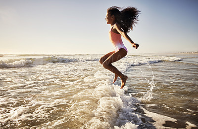 Buy stock photo Shot of a young girl having fun at the beach
