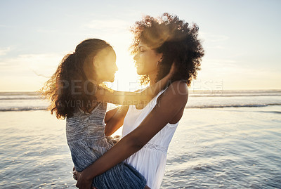 Buy stock photo Shot of a mother and her little daughter bonding together at the beach