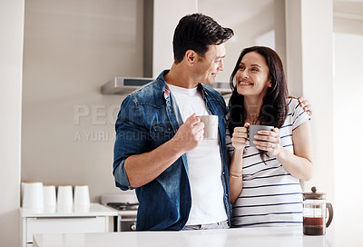 Buy stock photo Shot of a happy young couple having coffee together at home