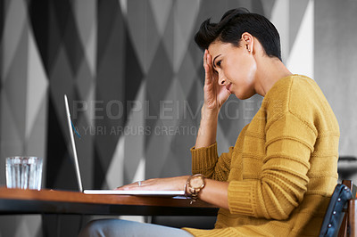 Buy stock photo Cropped shot of an attractive young businesswoman looking stressed out while working in her office