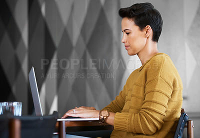 Buy stock photo Cropped shot of a confident and attractive young businesswoman working in her office