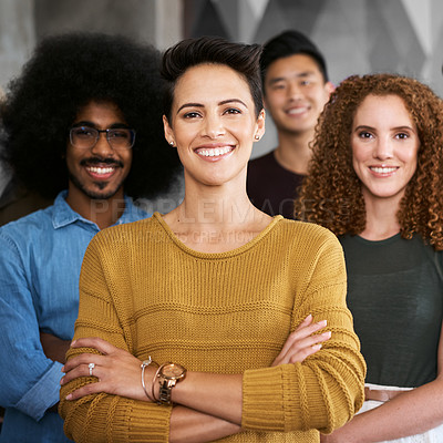 Buy stock photo Cropped portrait of a group of designers standing with their arms folded in a creative office