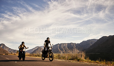 Buy stock photo Shot of young women riding their motorcycles outdoors