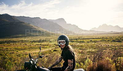 Buy stock photo Portrait of a young woman riding her motorcycle through the countryside