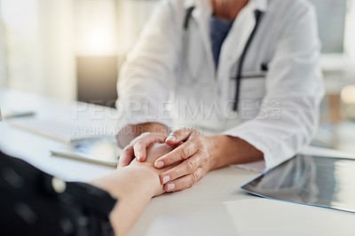 Buy stock photo Cropped shot of an unrecognizable female doctor holding a patient's hand in comfort in her office in the hospital
