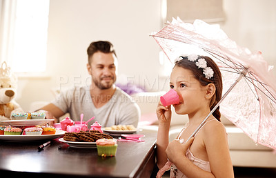 Buy stock photo Shot of a father and his little daughter having a tea party together at home
