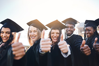 Buy stock photo Portrait of a group of students showing thumbs up on graduation day