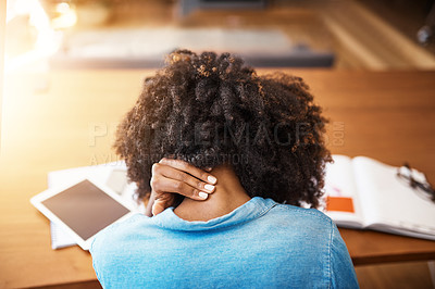 Buy stock photo Rearview shot of a young woman holding her neck in pain at home