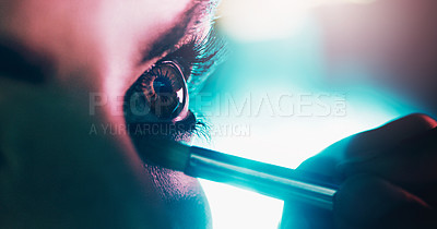 Buy stock photo Closeup shot of a young woman applying eyeshadow on her eyes backstage