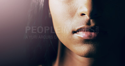 Buy stock photo Closeup shot of a young woman's beautiful lips against a dark background