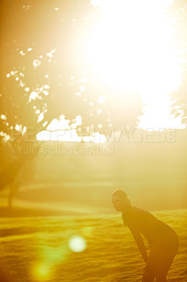 Buy stock photo Shot of a sporty young woman taking a break while exercising outdoors