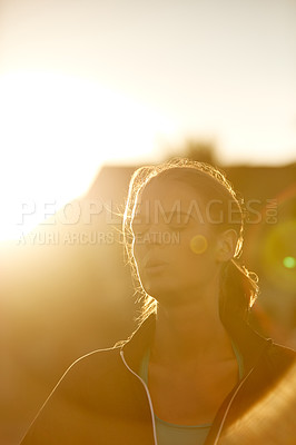 Buy stock photo Shot of an attractive young woman running outdoors