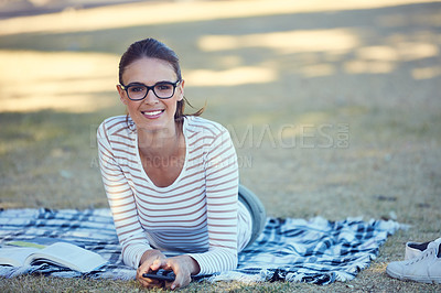 Buy stock photo Portrait of an attractive young woman relaxing in the park