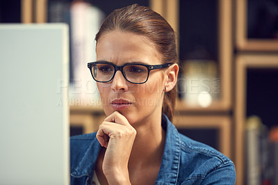 Buy stock photo Shot of a young businesswoman using a computer in a modern office