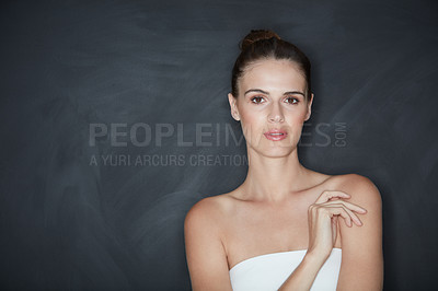 Buy stock photo Cropped shot of a beautiful young woman posing against a dark background