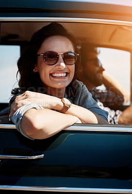 Buy stock photo Portrait of a young woman out on a road trip with her partner