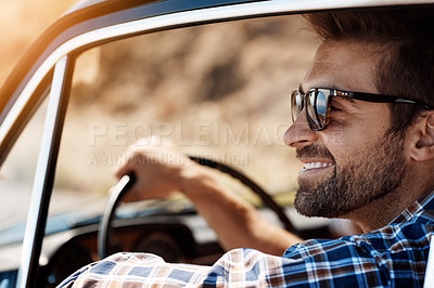 Buy stock photo Cropped shot of a handsome man enjoying a summer road trip