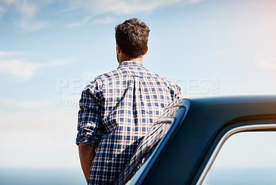 Buy stock photo Rearview shot of a young man looking at the view while on a road trip