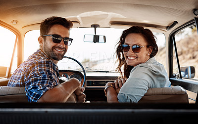 Buy stock photo Rearview portrait of an affectionate couple enjoying a summer road trip