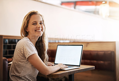 Buy stock photo Cropped shot of an attractive young female student studying in a coffee shop