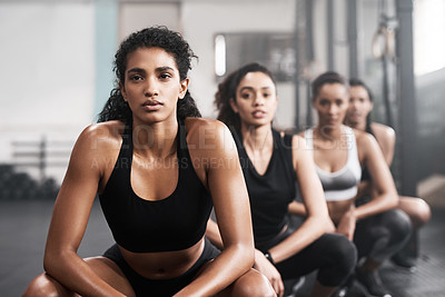 Buy stock photo Portrait of a group of fit young women working out at the gym