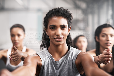 Buy stock photo Shot of a group of fit young women working out at the gym