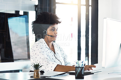 Buy stock photo Cropped shot of a young woman working in a call center