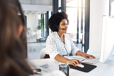 Buy stock photo Shot of a call centre agent working in an office