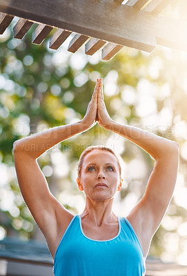 Buy stock photo Closeup shot of a mature woman doing yoga exercises outside her house in the morning