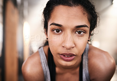 Buy stock photo Portrait of a sporty young woman working out in a gym