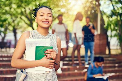 Buy stock photo Cropped portrait of an attractive young female university student on campus with her classmates in the background