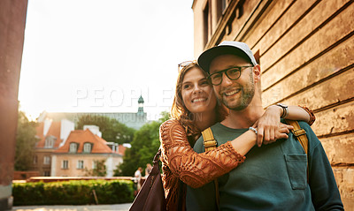 Buy stock photo Cropped shot of an affectionate couple exploring a foreign city