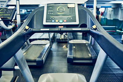 Buy stock photo Cropped shot of treadmills in an otherwise empty gym