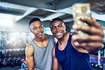Buy stock photo Cropped portrait of two handsome young athletic men taking selfies in the gym