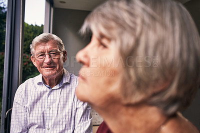 Buy stock photo Cropped shot of an affectionate senior couple in their backyard at home