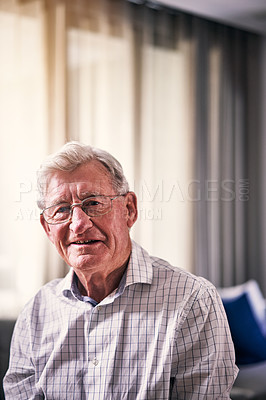 Buy stock photo Cropped portrait of a handsome senior man standing in his retirement home alone