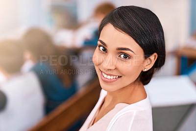 Buy stock photo Shot of a cheerful young female teacher giving class to her students inside a school during the day
