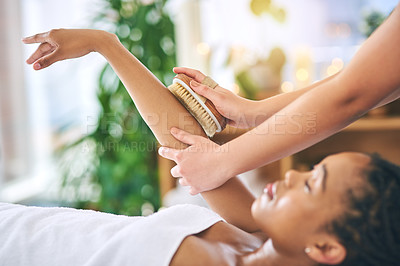 Buy stock photo Shot of an attractive young woman getting an exfoliating treatment at a spa