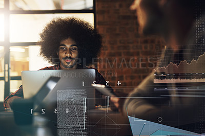 Buy stock photo Shot of a handsome young businessman working on his computer during a meeting with colleagues at work